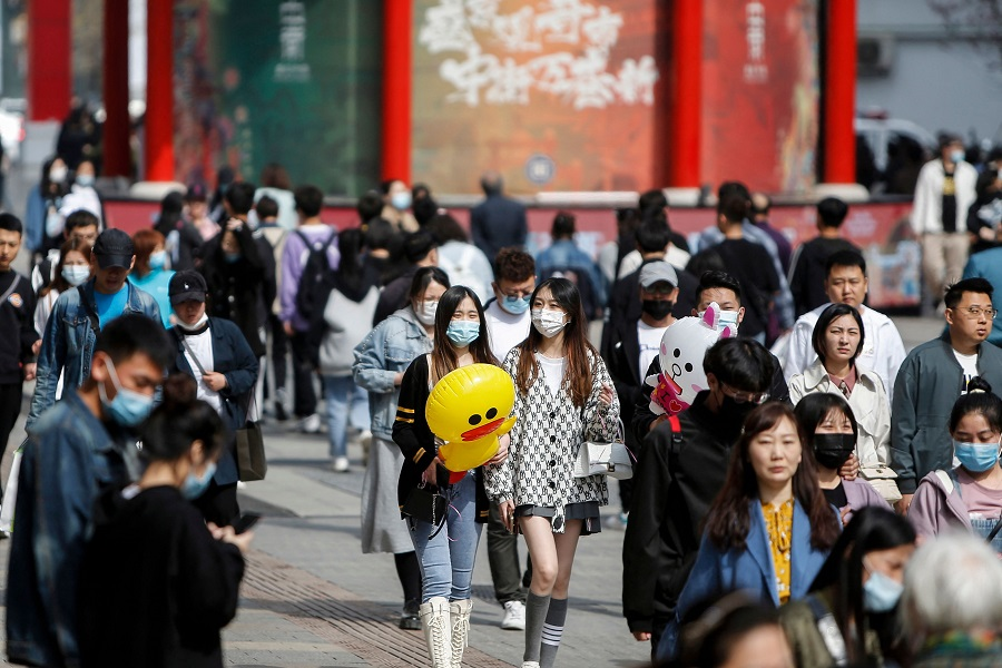 This photo taken on 4 May 2021 shows people visiting a business street in Shenyang, Liaoning province, China. (STR/AFP)