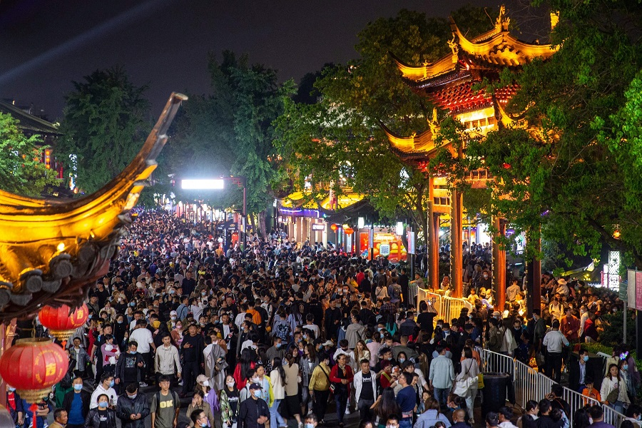 This photo taken on 4 May 2021 shows people visiting Fuzimiao, also called Confucian Temple, in Nanjing, Jiangsu province, China. (STR/AFP)