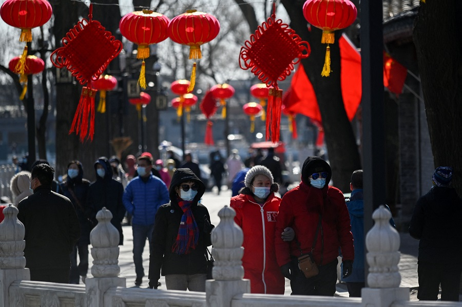 People visit a business street in Beijing, China, on 17 February 2021. (Wang Zhao/AFP)