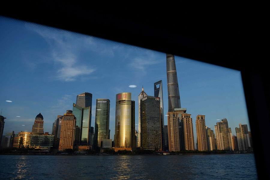 The Lujiazui financial district is seen from a ferry on the Huangpu river in Shanghai, China, on 30 August  2021. (Greg Baker/AFP)