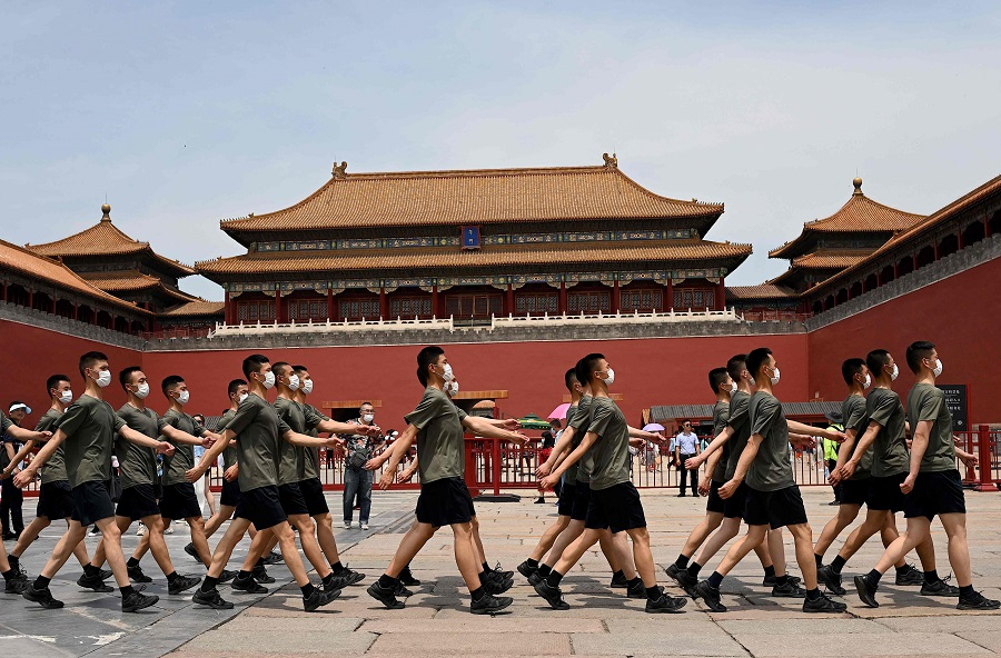 Chinese People's Liberation Army (PLA) soldiers march past the entrance of the Forbidden City in Beijing, China, on 12 June 2021. (Noel Celis/AFP)