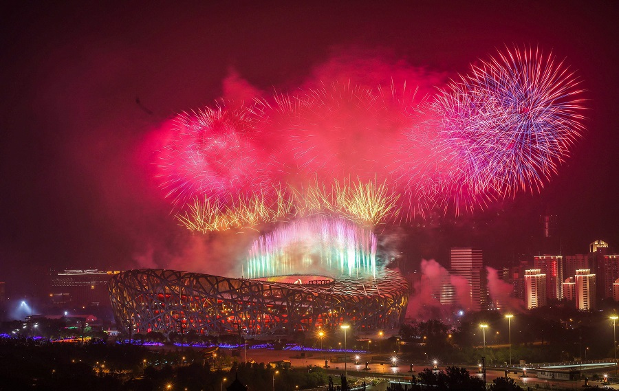 This photo taken on 28 June 2021 shows fireworks exploding during an art performance held at the Bird's Nest national stadium to mark the upcoming 100th anniversary of the founding of the Chinese Communist Party, in Beijing, China. (STR/AFP)
