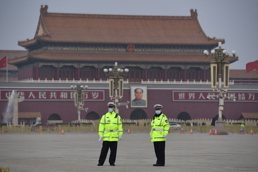 Police officers keep watch at Tiananmen Square ahead of the closing session of the National People's Congress in Beijing, China, on 11 March 2021. (Nicolas Asfouri/AFP)