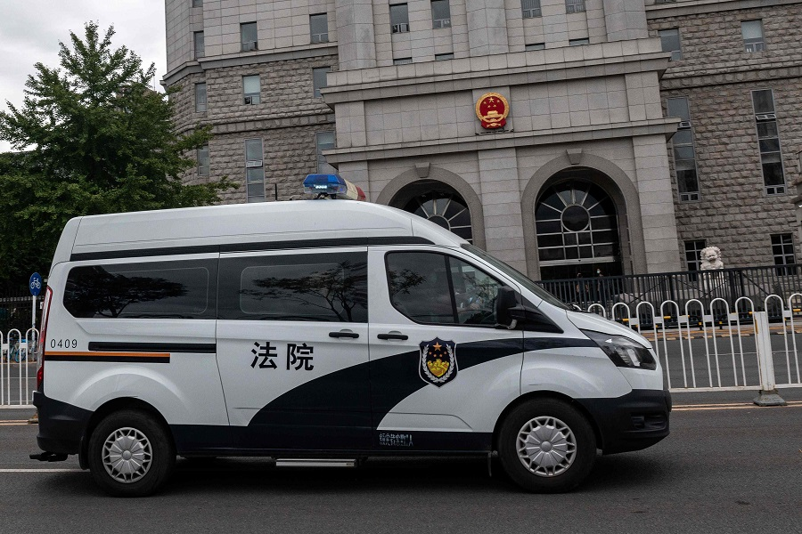 An escorted police van carrying Chinese property tycoon Ren Zhiqiang leaves the Beijing No. 2 Intermediate People's Court on 11 September 2020, after Ren's case was heard. Ren was detained after penning an essay fiercely critical of President Xi Jinping's response to the coronavirus outbreak. (Nicolas Asfouri/AFP)