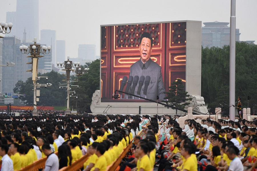 Chinese President Xi Jinping (on screen) delivers a speech during the celebrations of the 100th anniversary of the founding of the Communist Party of China at Tiananmen Square in Beijing, China, on 1 July 2021. (Wang Zhao/AFP)