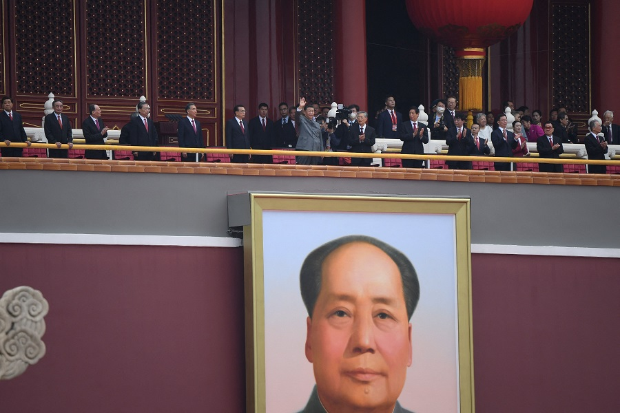 Chinese President Xi Jinping waves at the celebration marking the 100th anniversary of the founding of the Communist Party of China in Beijing, China, on 1 July 2021. (Wang Zhao/AFP)