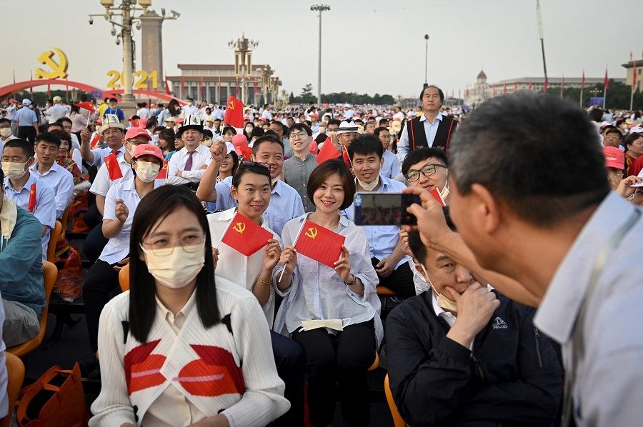 People pose for a picture before the celebration parade in Beijing, China, on 1 July 2021, to mark the 100th anniversary of the founding of the Communist Party of China. (Wang Zhao/AFP)