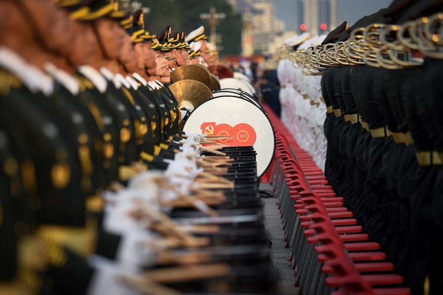 A Chinese military band prepares for celebrations in Beijing on 1 July 2021, to mark the 100th anniversary of the founding of the Communist Party of China. (Wang Zhao/AFP)
