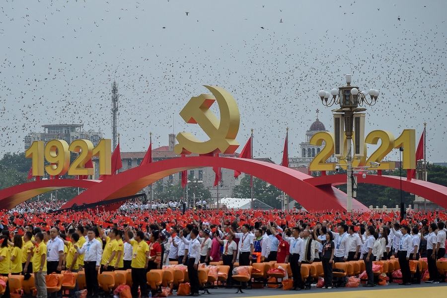 Doves fly during the celebrations marking the 100th anniversary of the founding of the Communist Party of China, in Beijing, China, on 1 July 2021. (Wang Zhao/AFP)