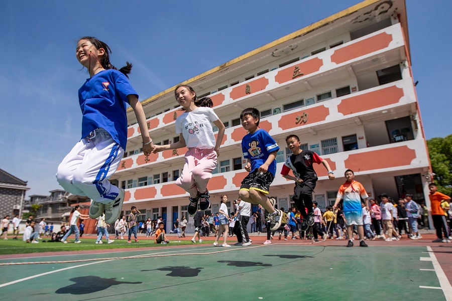 Elementary school students play on Children's Day in Hai'an, Jiangsu province, China, on 1 June 2021. (STR/AFP)