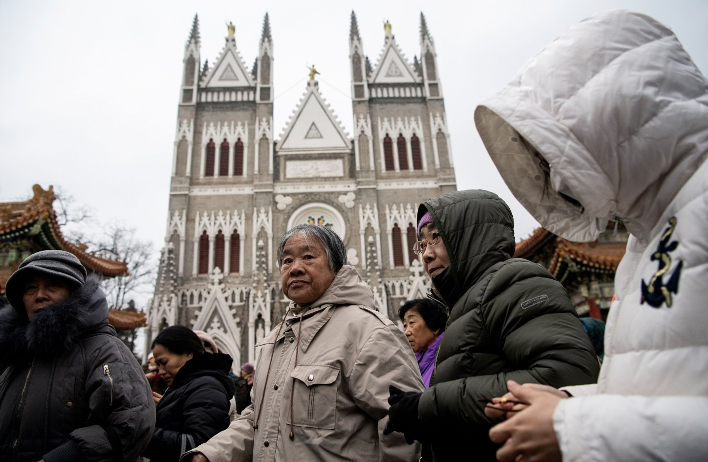 Worshippers attend a Christmas eve mass at the Xishiku Cathedral in Beijing on 24 December 2019. (Noel Celis/AFP)