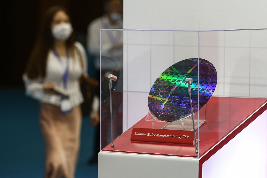A chip by Taiwan Semiconductor Manufacturing Company (TSMC) is seen at the 2020 World Semiconductor Conference in Nanjing, Jiangsu province, China, on 26 August 2020. (STR/AFP)