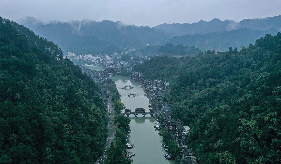 This aerial photo taken on 25 September 2020 shows the ancient town of Fenghuang in Xiangxi, in China's Hunan province. (STR/AFP)