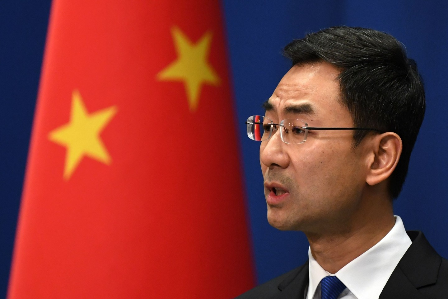 Chinese Foreign Ministry spokesperson Geng Shuang speaks during the daily press briefing in Beijing on 18 March 2020. (Greg Baker/AFP)