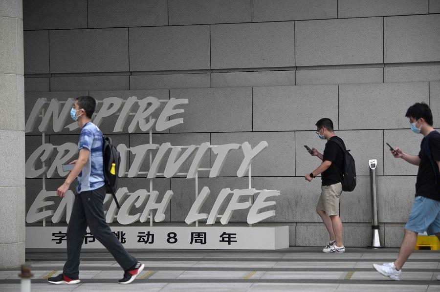 Employees walk outside the headquarters of ByteDance, the owner of video sharing app TikTok, in Beijing on 5 August 2020. (Noel Celis/AFP)