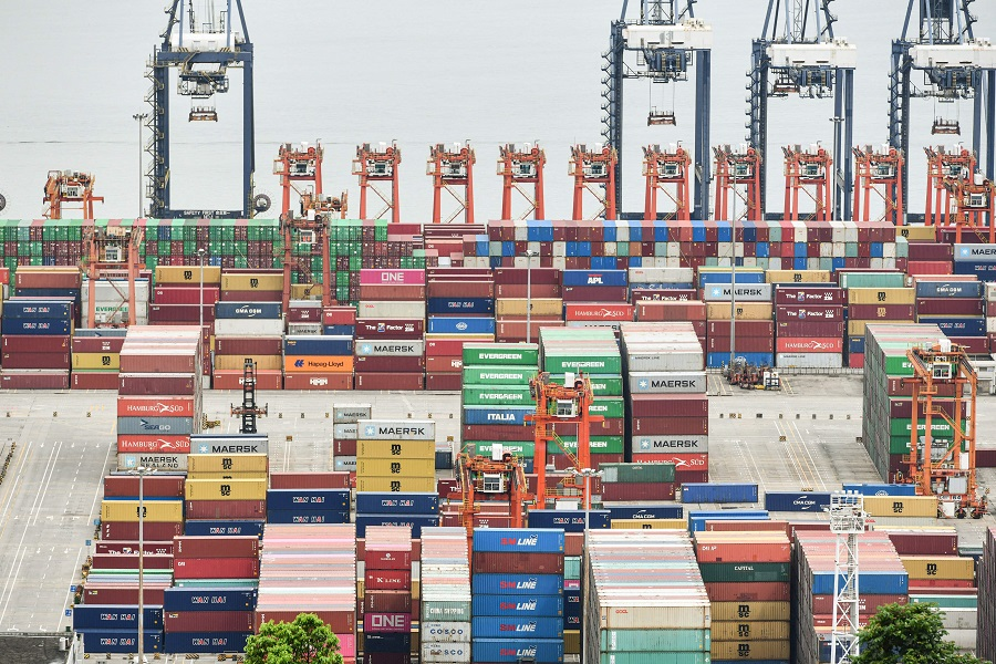 This aerial photo taken on 22 June 2021 shows cargo containers stacked at Yantian port in Shenzhen, Guangdong province, China. (STR/AFP)