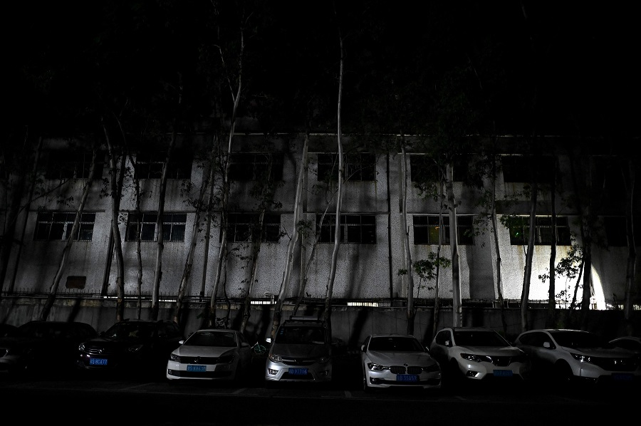 This picture shows a building of an industrial park in Houjie, in Dongguan, Guangdong province, China, on 30 September 2021, an area hit by power restrictions. (Noel Celis/AFP)
