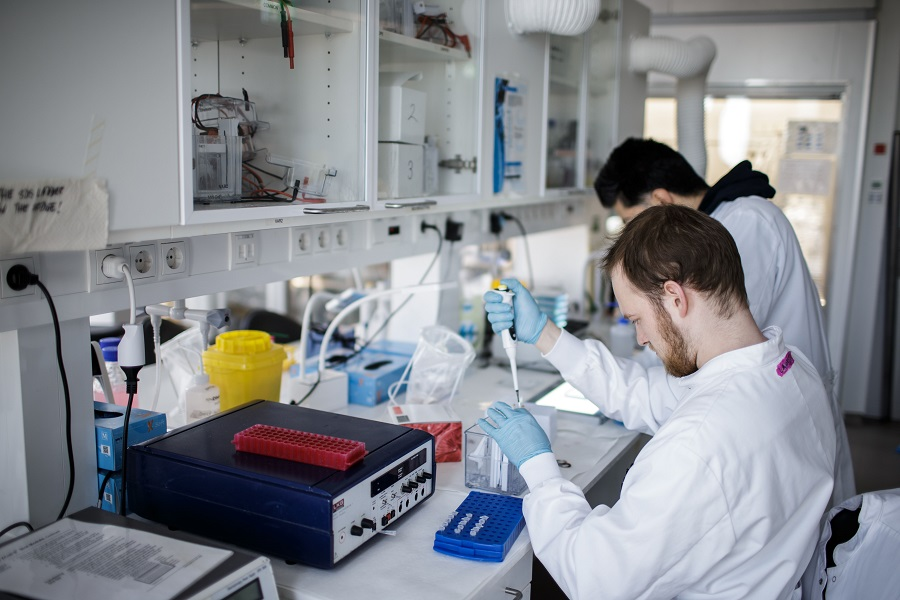 Researchers work on a vaccine against the Covid-19 coronavirus at a research lab in the University of Copenhagen, in Denmark, on 23 March 2020. (Thibault Savary/AFP)