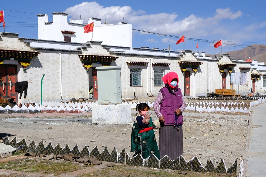 Chinese flags are placed above every house at the government-built residential area in Tibet.