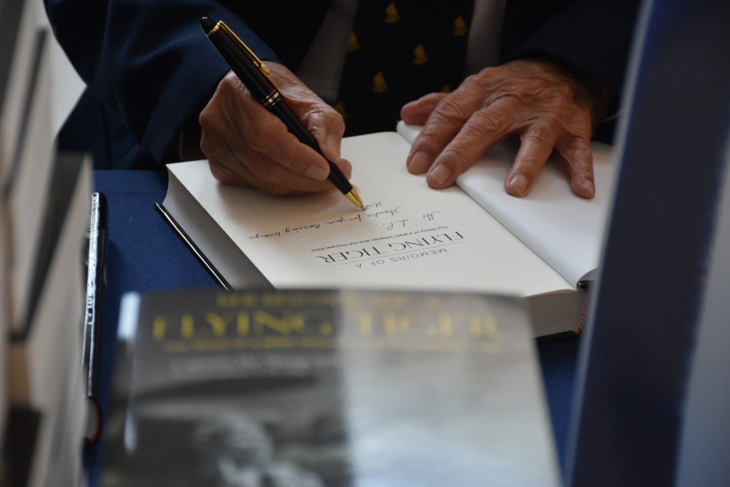 Ho at his book signing event. (World Scientific)