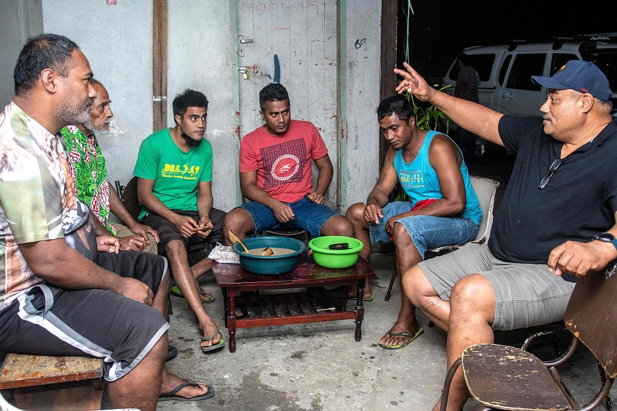 This photo taken on 5 August 2020 shows local residents drinking kava at Mauri Kava Bar in Suva, Fiji. (Leon Lord/AFP)