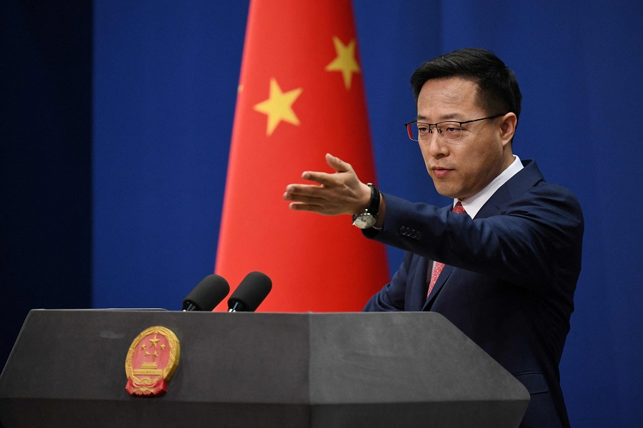 This file photo taken on 8 April 2020 shows Chinese Foreign Ministry spokesman Zhao Lijian taking a question at the daily media briefing in Beijing. (Greg Baker/AFP)