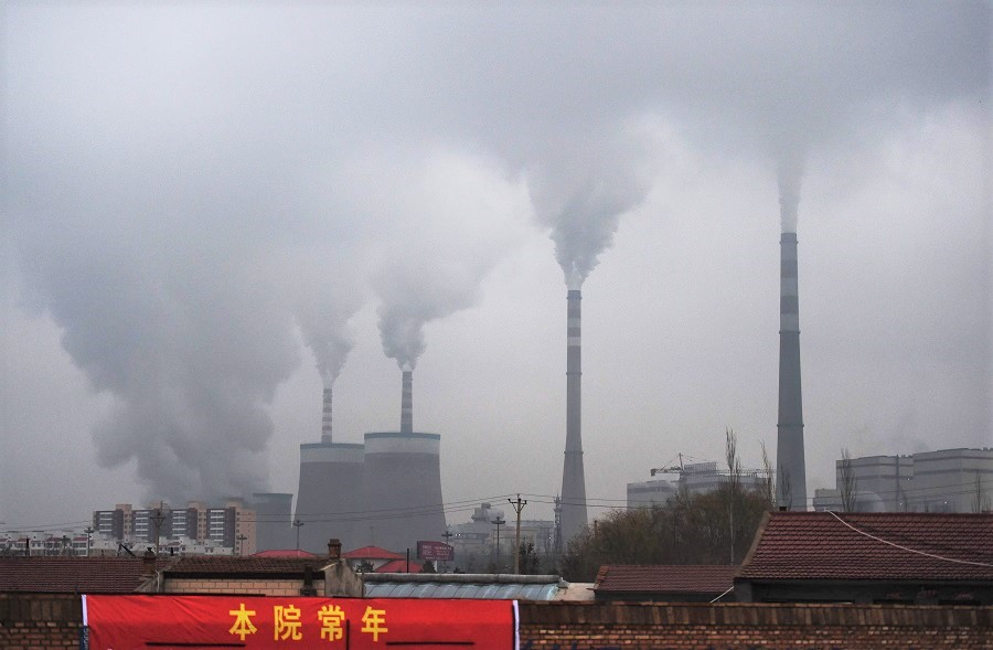 This file photo taken on 19 November 2015 shows smoke belching from a coal-fired power station near Datong, Shanxi province, China. (Greg Baker/AFP)
