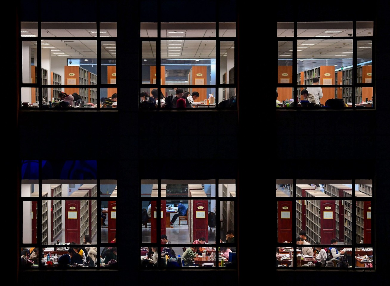 This photo taken on December 18, 2018 shows university students preparing for the upcoming National Entrance Examination for Postgraduate (NEEP) at a library of the Shenyang Agricultural University in Shenyang, Liaoning province. (STR/AFP)