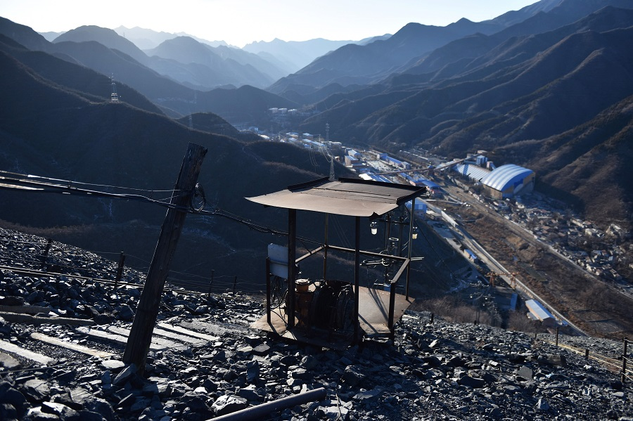 In this file photo taken on 11 December 2019, mining equipment on a mountain of rocks above the Datai coal mine in Mentougou, west of Beijing, is seen. China is closing more of its coal mines to cut carbon emissions and switch to renewables. (Greg Baker/AFP)