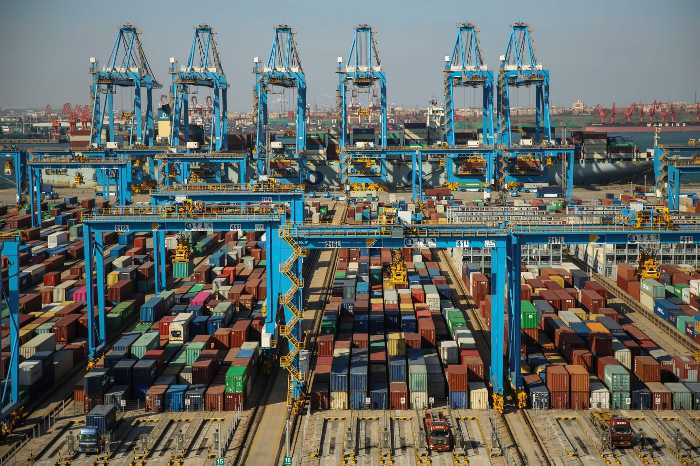 China's economic miracle has transformed a poor country into the second largest economy in the world. This file photo taken on November 28, 2019 shows containers stacked up at an automatic dock in Qingdao in China's eastern Shandong province. (STR/AFP)