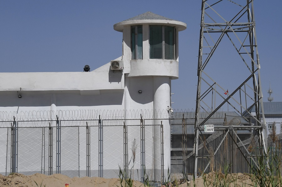 This file photo taken on 31 May 2019 shows a watchtower on a high-security facility near what is believed to be a re-education camp where mostly Muslim ethnic minorities are detained, on the outskirts of Hotan, Xinjiang, China. (Greg Baker/AFP)