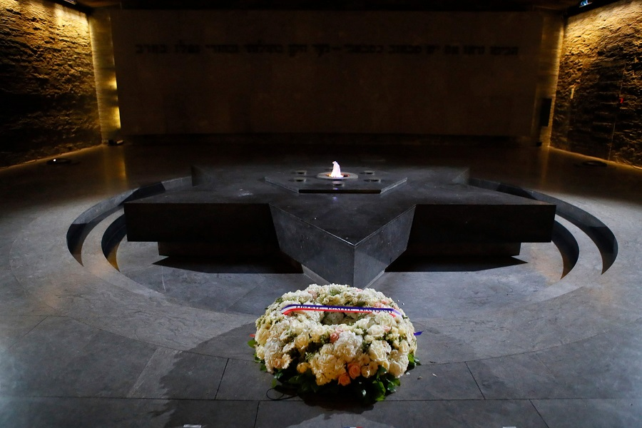 In this file photograph taken on 19 February 2019, a wreath of flowers lies at The Shoah Memorial, a Holocaust museum in Paris, ahead of the arrival of the French President. (Francois Mori/POOL/AFP)