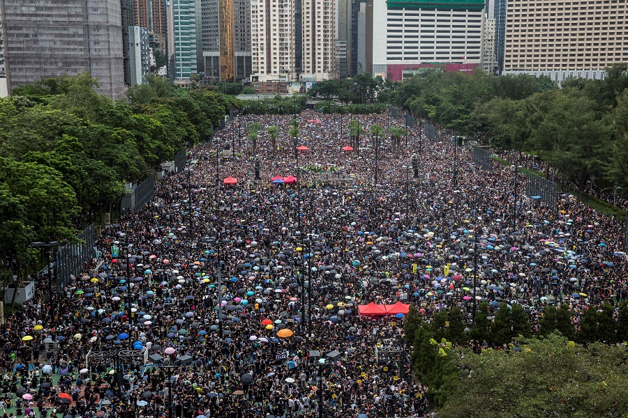 In this file photo taken on 18 August 2019, protesters gather for a rally in Victoria Park in Hong Kong, in opposition to a planned extradition law that had morphed into a wider call for democratic rights in the semi-autonomous city. (Isaac Lawrence/AFP)
