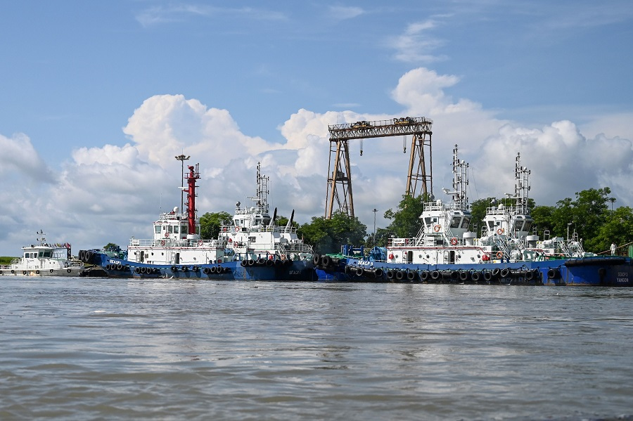 In this file photo taken on 2 October 2019, vessels are docked at a port of a Chinese-owned oil refinery plant on Made Island off Kyaukpyu, Rakhine State. (Ye Aung Thu/FP)