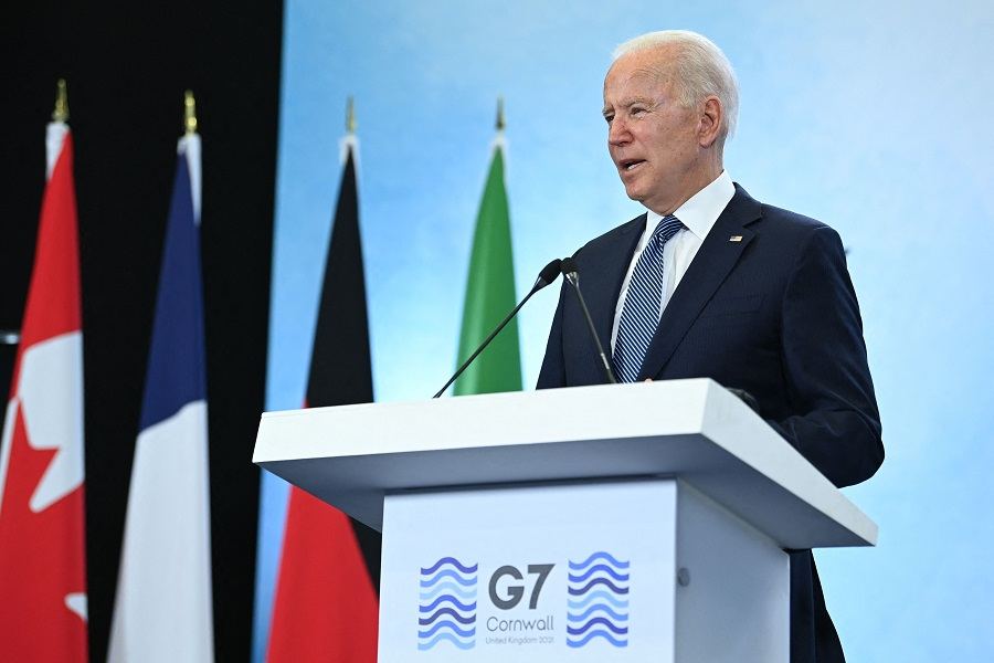 In this file photo, US President Joe Biden takes part in a press conference on the final day of the G7 summit at Cornwall Airport Newquay, near Newquay, Cornwall, on 13 June 2021. (Brendan Smialowski/AFP)