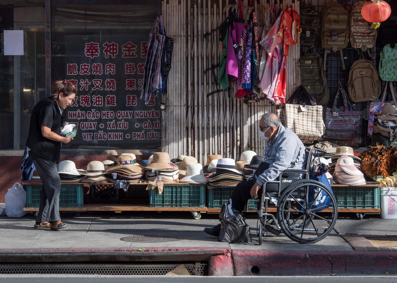 This file photo taken on 13 February 2020 shows shoppers at a deserted Los Angeles Chinatown as most stay away due to fear of the novel coronavirus, Covid-19. Chinatowns in Western countries have fallen quiet and businesses are struggling to survive as fears over the deadly novel coronavirus outbreak ripple around the world. (Mark Ralston/AFP)