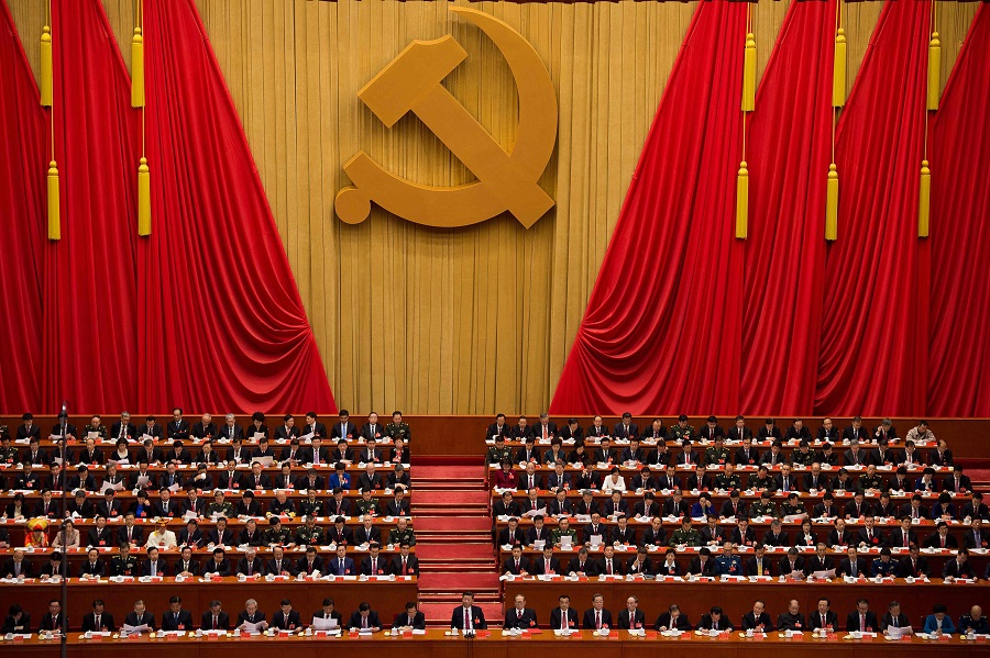 In this file photo taken on 23 October 2017, delegates attend the closing of the 19th Communist Party Congress at the Great Hall of the People in Beijing. (Nicolas Asfouri/AFP)