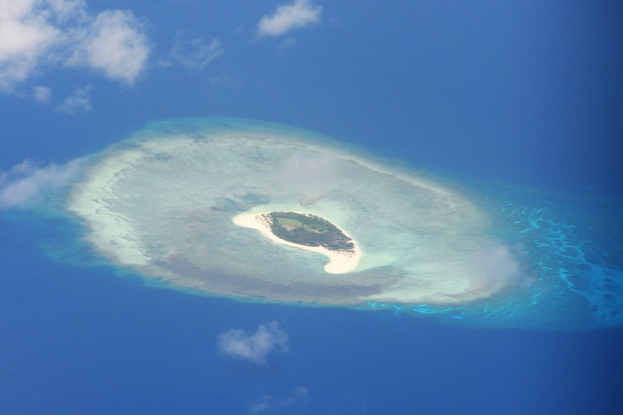 This file photo taken on 21 April 2017 shows an aerial shot of a reef in the disputed Spratly islands. (Ted Aljibe/AFP)