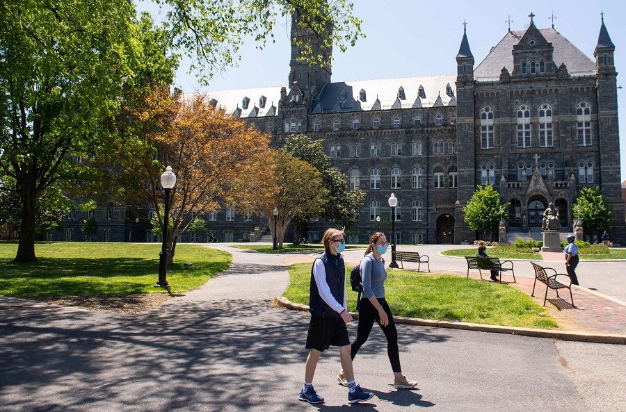 In this file photo taken on 7 May 2020, the campus of Georgetown University is seen nearly empty as classes were cancelled due to the Covid-19 pandemic, in Washington, DC. (Saul Loeb/AFP)