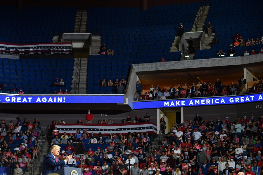 In this file photo, the upper section of the arena is seen partially empty as US President Donald Trump speaks during a campaign rally at the BOK Center on 20 June 2020 in Tulsa, Oklahoma. (Nicholas Kamm/AFP)