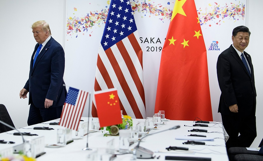 In this file photo taken on 29 June 2019, US President Donald Trump and Chinese President Xi Jinping attend a bilateral meeting on the sidelines of the G20 Summit in Osaka. (Brendan Smialowski/AFP)