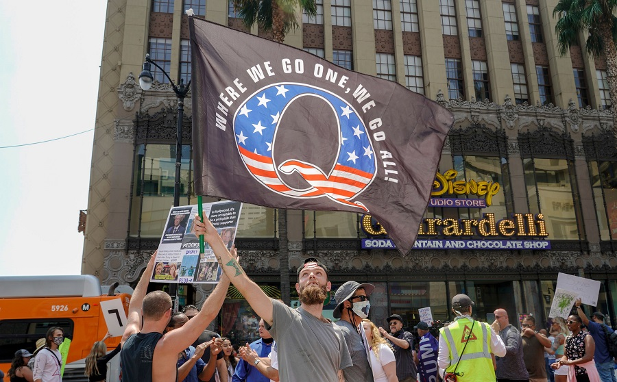 In this file photo taken on 22 August 2020, conspiracy theorist QAnon demonstrators protest child trafficking, on Hollywood Boulevard in Los Angeles. (Kyle Grillot/AFP)