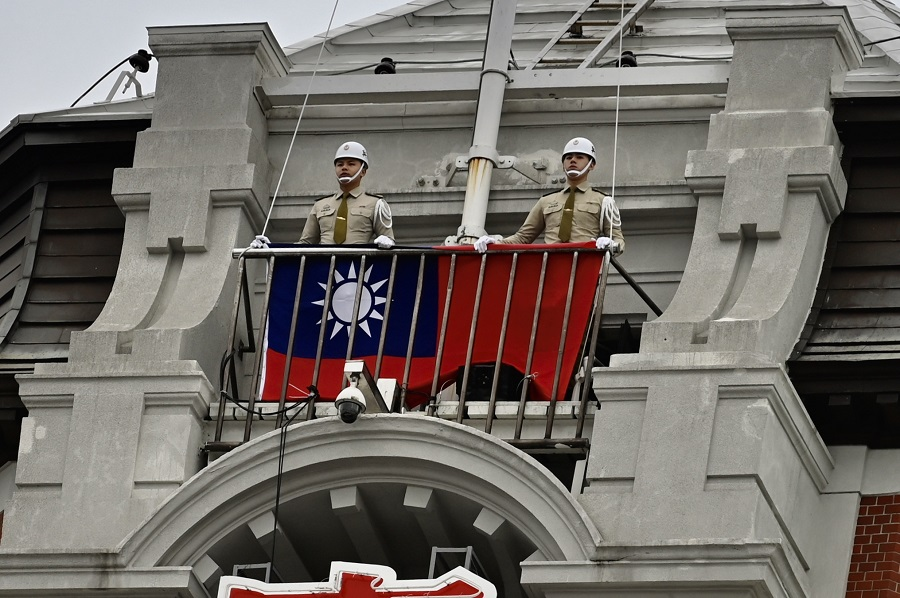 In this file photo, Taiwan's military police prepare to raise the Taiwanese flag during a ceremony to mark Taiwan's Double Ten Day at the Presidential Office in Taipei on 10 October 2020. (Sam Yeh/AFP)