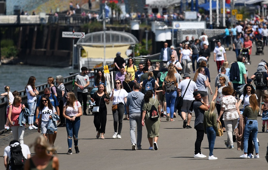 People walk at the Rhine promenade of Dusseldorf, Germany, on 12 July 2020. (Photo by Ina Fassbender/AFP)