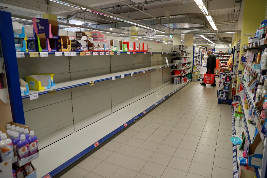 An empty shelf is pictured in a supermarket where toilet paper is sold out in Frankfurt, eastern Germany, where people panic buy in a reaction to the spread of Covid-19. (Odd Andersen/AFP)
