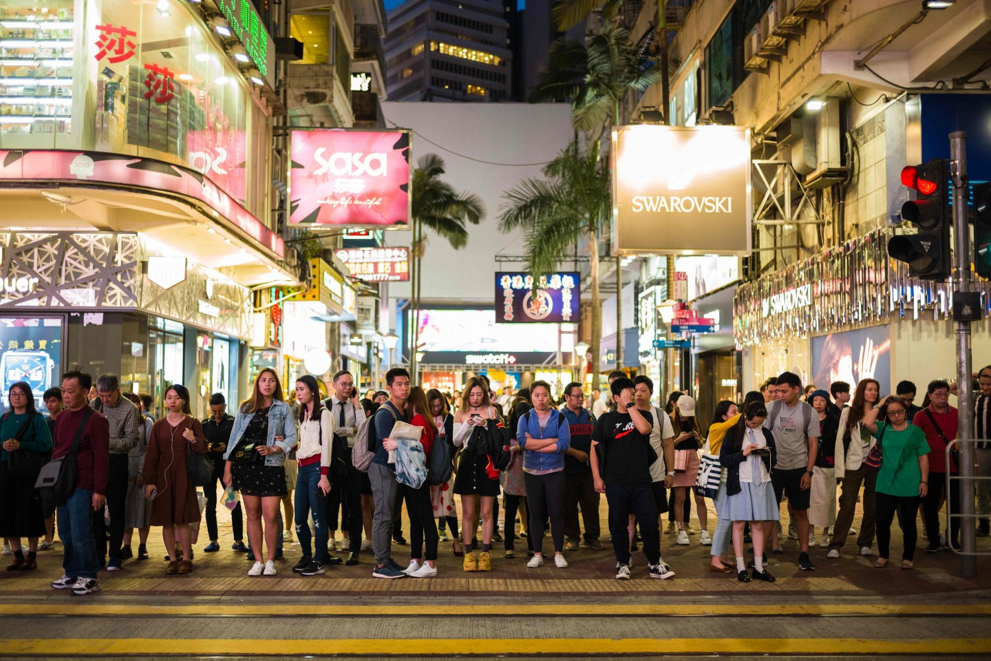 Hong Kong is an international metropolis and both Chinese and English are the official languages. Pictured here are pedestrians preparing to cross a road in the popular shopping district of Causeway Bay in Hong Kong. (Photo by Anthony Wallace/AFP)