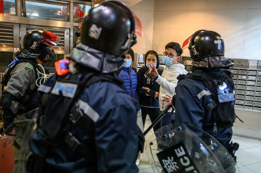 Protesters threw petrol bombs on the night of 26 January 2020 at an empty public housing complex in Hong Kong that had been earmarked to become a temporary quarantine zone as the city battles the Covid-19 outbreak. (Philip Fong/AFP)