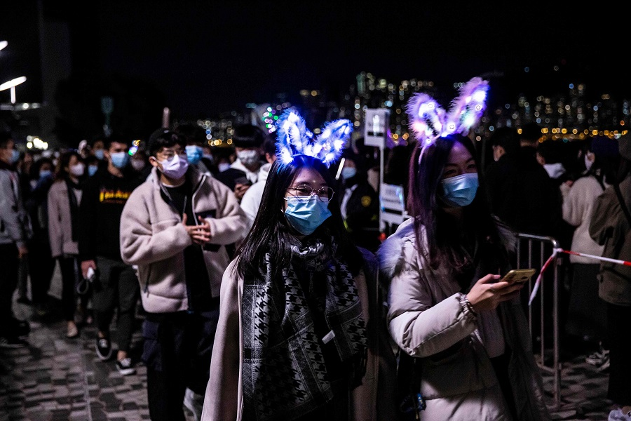 People wearing light headsets gather at Victoria Harbour, Hong Kong, on 31 December 2020. (Isaac Lawrence/AFP)