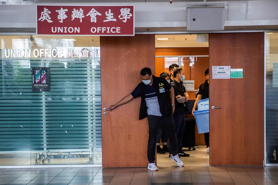 Police from the National Security Division arrive at the Hong Kong University Students' Union building to conduct a search in Hong Kong, China, on 16 July 2021. (Isaac Lawrence/AFP)