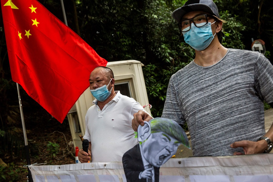 Protesters demonstrate outside the US consulate in Hong Kong on 8 August 2020, after the US imposed sanctions on Hong Kong Chief Executive Carrie Lam and other top officials in response to Beijing enacting a national security law on the city. (Photo by Isaac Lawrence/AFP)